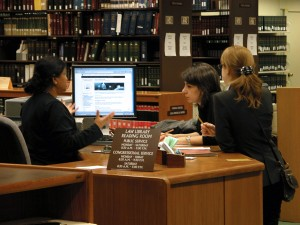 Reference-Librarian-assisting-readers-1