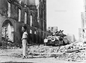 Egyptian Boy Standing near British Tank