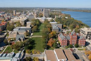 An aerial view from a helicopter highlights the central portion of the UW-Madison campus including the historic Bascom Hill area during a sunny autumn day on Oct. 7, 2006. Clockwise from lower left is Music Hall, the Law Building, South Hall, Bascom Hall, North Hall, the Education Building and Science Hall. In the background is Picnic Point and the Lake Mendota shoreline. ©UW-Madison University Communications 608/262-0067 Photo by: Jeff Miller Date: 10/06    File#:   D200 digital camera frame 1178